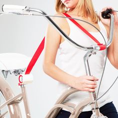 A bicycle shoulder strap designed to help transport bikes up hills or stairs.