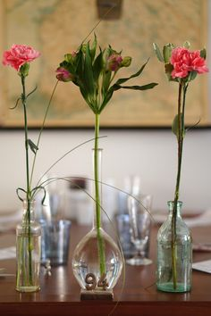 A supermarked bouquet divided in vintage bottles, #flowers