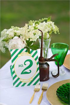 wizard of oz themed table number by paper & ink designs #greenweddingideas #themedwedding #wizardofoz http://www.weddingchicks.com/2014/01/09/wizard-of-oz-wedding-ideas/