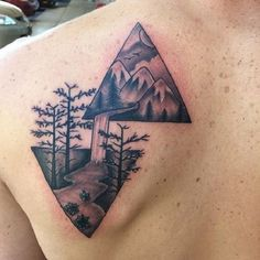 Twin and inverted Triangle Glyph Tattoos. Both triangle symbols are artistically connected with each other. You can see that they combined to form a mountain scene with a waterfall and river as well as trees surrounding it. The design gives off a calm and collected vibe.