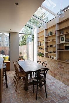 A wall of storage filled with art and ceramics features inside this house that architect Neil Dusheiko has renovated for his father-in-law, near his own home in north London. Küchen Design, House Design, Interior Design, Loft Design, Urban Design, House Extension Design, Victorian Terrace, House Extensions, Cuisines Design