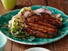 To make these Grilled Korean-Style BBQ Glazed Pork Chops with Red Onions and Baby Bok Choy, coat the tender grilled pork chops and onions in hoisin sauce.