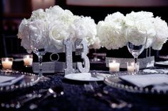 Some of our photos, featured on TheKnot.com!  The floral arrangements were wrapped in a coordinating black lace and crystals, and the bride made silver glittering table numbers to tie the theme together.