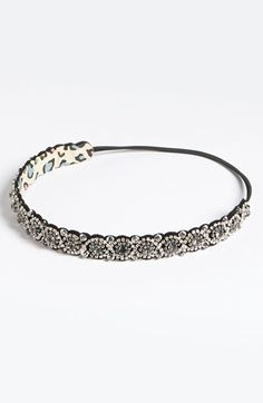 Choose a slim beaded headband to feminize a masculine cut. Let long or asymmetrical bangs hang free or use it to pull them back for a sleeker style. For a vintage, 1920s flair, pull close-to or down over your forehead.