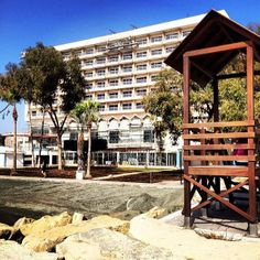Poseidonia Beach Hotel from the beach...scaffoldings on the basement and ground level as well as on the 6th floor! @poseidoniabeachhotel #renovation #hotel #cyprus #limassol #beachhotel #beach #poseidoniabeachhotel — at Poseidonia Beach Hotel.