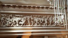 Carving above fireplace
