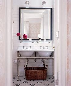 bathroom - looks like a fairly small double sink that does big duty. Love the huge mirror too!