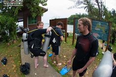 Teachers and students of the group assist one another to don their dive equipment and then they will do a buddy check!