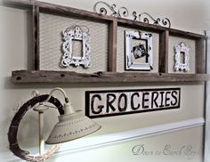 make a rustic ladder from old boards and attach chicken wire.  use twine to hang frames.