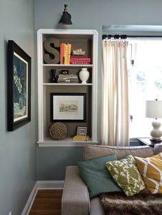 Need help styling your bookcase? Paint the back of the bookcase with a contrasting or complimentary color. Group books together by color and alternate horizontal and vertical placement, and use decorative items for bookends. Large initial letters, wicker orbs, vases, picture frames and other accessories can be found at HomeGoods.  Add colorful accent pillows and cozy throw blankets for additional color, pattern, texture and style to your living space. (Sponsored)