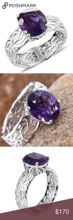 NWOT Genuine Lusaka Amethyst Platinum/SS Ring 7 NWOT Genuine Lusaka Amethyst Platinum over SS Ring, SIZE 7. Exquisitely laced sterling silver band. Platinum over sterling silver. The darkest and most sought after Amethyst. Don't settle for anything less.  4.30 cts center stone.  12 x 10 faceted.  SIZE 7   If you are looking for something else, please let me know and my supplier will get it for you. Lusaka Jewelry Rings