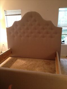 The DIY headboard, footboard and side rails my Hubs and I built and tufted.