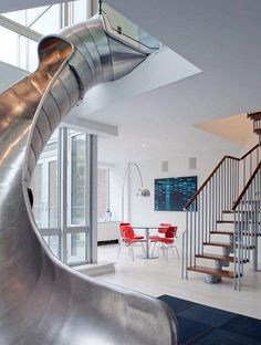 Note to self: get slide in apartment.   http://inthralld.com/2012/02/east-village-helical-slide-penthouse-in-new-york-city/