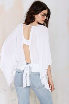 The Bell On Earth Cutout Top is some serious summer goodness with trousers and slides, or rock with skinnies and platforms for a night on the town.