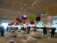 These colored lanterns at the Arts & Tannery expo are so cute and really brighten up the white room