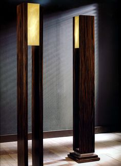 Grand scale macassar ebony floor lamps or lighting torchers. These large scale…