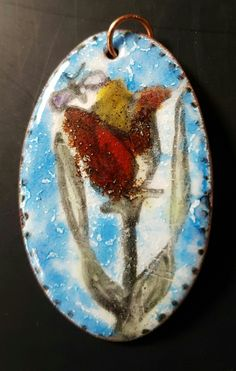 Enamel painted on copper: a pendant