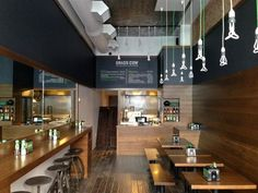Industrial Metal Stools Add Rustic Edge to NYC Restaurant | Blog | BarnLightElectric.com