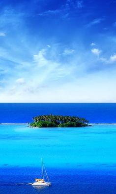 Sailboat near a remote tropical island. #sail #yacht #island