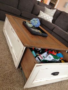 Free and easy woodworking plans with step by step photos showing you how to build a DIY coffee table with drawers on both sides for tons of storage.