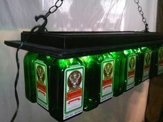 This is a Quality Handmade Jager Pool Bar light / Table Jagermeister Pool Table Chandelier Designed and Hand Made From Recycled ( Jagermeister 1 Liter ) Liquor Bottles From bottles saved by local restaurants, bars and local area shops. We re-purpose these bottles by taking our time and turning them into great looking Lights for you and your friends to enjoy.