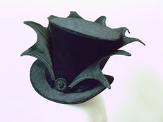 Batty Top Hat. First make from cardboard, then cover with black or very deep purple velvet. Lastly ad the bat sculpture and voila !