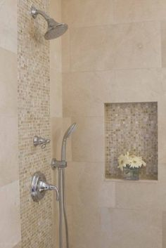 This is a great look!  Crema Marfil marble used here I prefer porcelain tiles (less maintenance but looks same) Waterfall look using honey onyx tiles