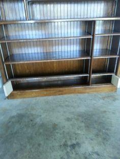 My grandson's bookcase displaying hidden storage on the bottom.