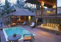 16 Stunning Nipa Huts That's Basically Your Dream House - Strandhaus Outdoor Spaces, Outdoor Living, Outdoor Decor, Bungalows, Bamboo House, Tropical Houses, Tropical House Design, Tropical Paradise, Tropical Garden