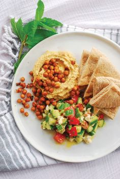 The mediterranean hummus plate with smoky chickpeas is perfect for a quick weeknight dinner and clocks in at less than $3.50 a plate.