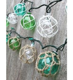 Vintage Glass-style Buoy Float String Lights - I love anything beachy, especially glass floats.These resin party lights are perfect for addi. Deco Marine, Glass Floats, Beach Room, Coastal Christmas, Beach Christmas, Christmas Store, Beach House Decor, Home Decor, Beach Theme Garden