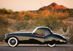 jaguar roadster de 1954 a jag... oh baby!!! my mum's before she pass away but was silver