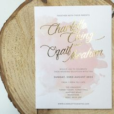 """A close up of the beautiful invite of @char3004  and @ozbozz  Loving the watercolour and gold foiling!  #silkscreen #screenprint #weddinginvites #weddings #invites #engagement #stationery #australia #gold #watercolour #goldfoiling #foiling #lovegold"""