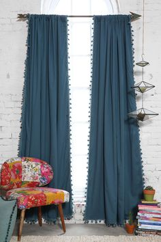 Comes in white, grey, teal. Urban Outfitters. Plum & Bow Blackout Pompom Curtain