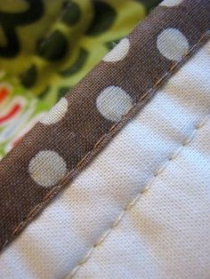 Binding Tutorial - the key to machine stitched binding is that you pin it just covering the stitching on the back where you attached the binding to the front of the quilt.
