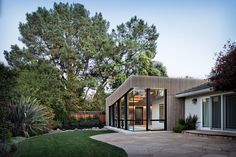 The geometric addition, with its cedar rain screen, is joined at the hip with the more traditional residence.