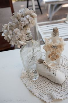 Simple and sweet vintage baby shower decor. Centerpieces using vintage bottles, doilies and baby shoes. | Vintage Baby Boy and Girl Baby Shower