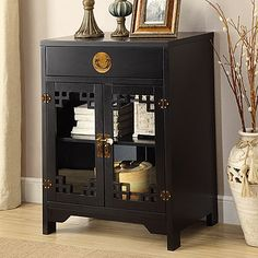 Black 2-Doors & One Drawer Chest at Big Lots.   http://www.biglots.com/p/c/accent-furniture/black-2-doors-one-drawer-chest
