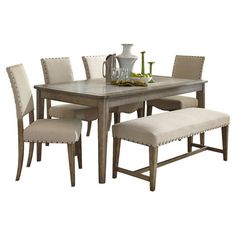 4 chairs and a bench? Lend a touch of understated elegance to your mealtimes with this stylish dining set, showcasing a weathered gray finish and nailhead trim details.