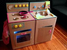 Adorable Card board Kitchen. Its pretty cool the things you can do with a card board box.