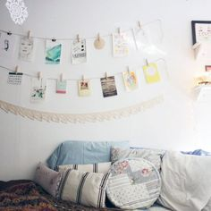 Check out this pretty white bedroom/studio for creative, inspiring ideas, including shelves, wall decor, and desk layout.
