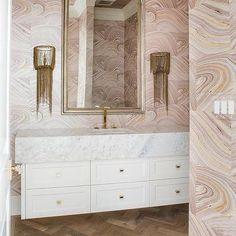 Pink Powder Room with Brown Fringe Sconces