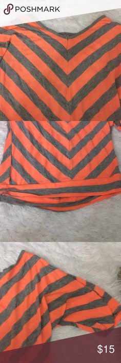 Striped top Orange and grey striped top Brand new and unused Very vibrant color palette on this top! Knitworks Tops Tees - Short Sleeve
