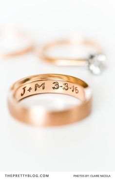A Gold Engraved Wedding Ring with the Couples Initials and Wedding Date | Photography by Claire Nicola | Rings by Larsen Jewellery