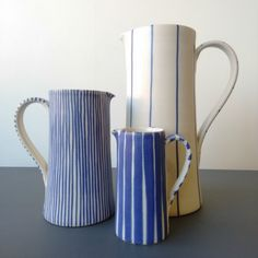 Influenced by the Rye Pottery, Sue's distinctive patterns are produced by brushing dilute cobalt over the dolomite glaze before firing to The seemingly endless combinations of. Bottle Painting, Bottles And Jars, Home Decor Trends, Modern Rustic, Drinkware, Decoration, Bellisima, Kettle, Decorative Accessories