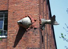 This is a sculpture of a salmon going through a building in Oregon. Trippy.