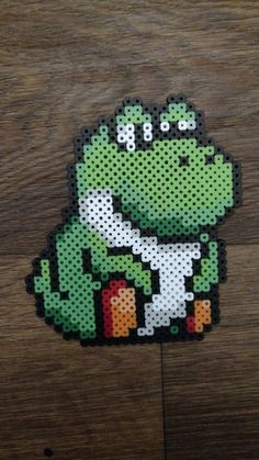 Fat Yoshi made out of perler beads. Perler Bead Templates, Pearler Bead Patterns, Diy Perler Beads, Perler Patterns, Hamma Beads 3d, Pearler Beads, Fuse Beads, Yoshi, Perler Bead Mario