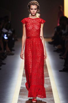 A very elegant red lace maxi dress from the Valentino Spring 2012 catwalk show. Cute cap sleeves and I love the skinny belt.