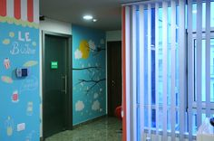 Relaxing zone designed for a busy office in Bucharest ~ view from the kitchen are ~