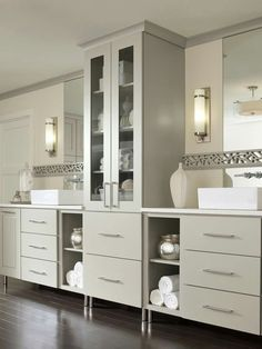 Design Tip: The key to lighting your bathroom is to provide shadow-free task lighting at the mirrors. In addition to an overhead vanity light, add side sconces with a companion close-to-ceiling light to reduce shadows on the sides of your face. Home, Sleek Bathroom, Bathroom Decor, Decora Cabinets, Beautiful Bathrooms, Sleek Bathroom Design, Painting Bathroom Cabinets, Grey Cabinets, Bathroom Design